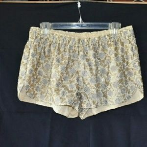 O'neill gold sequin embroidered shorts, size L.